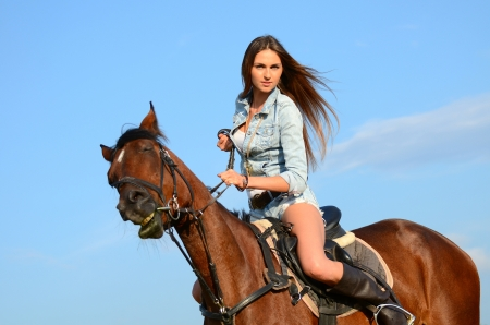 The woman on horse against the sky photo