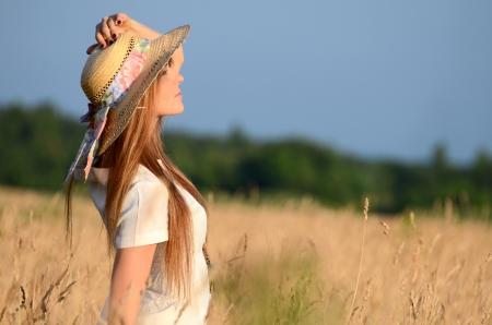 romanticism: The beautiful woman in dress in field