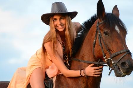 horseback: The woman on horse against the sky