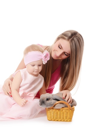 The little girl with mum and a grey rabbit photo