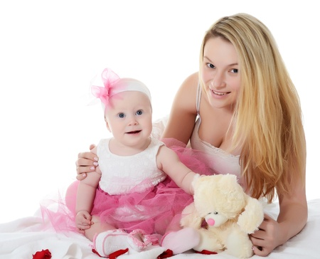 The happy mother with baby over white photo