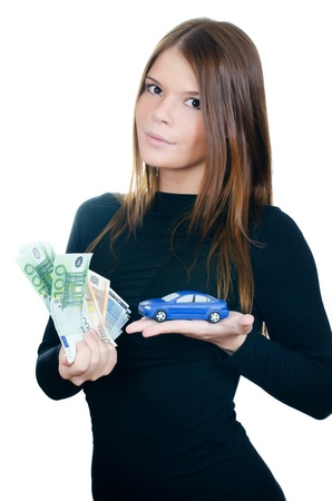 Beautiful woman with money and toy car photo
