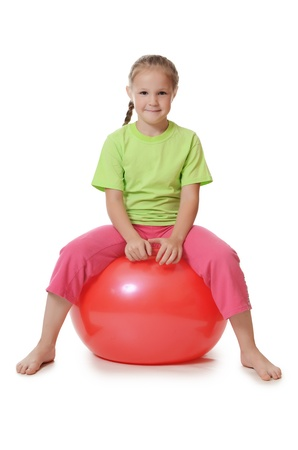 The little girl on a gymnastic ball photo
