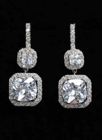 earrings: Silver earrings with jewels on the black
