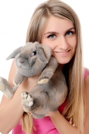 The beautiful woman with a grey rabbit isolated photo