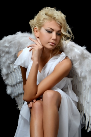 Beautiful girl in suit of white angel photo