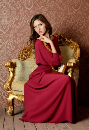 The elegant sensual woman in claret dress photo