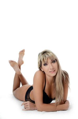 The beautiful woman in black underwear isolated photo