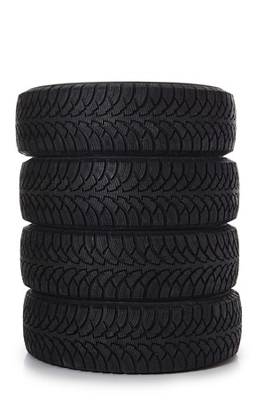 The automobile tire isolated on white background photo