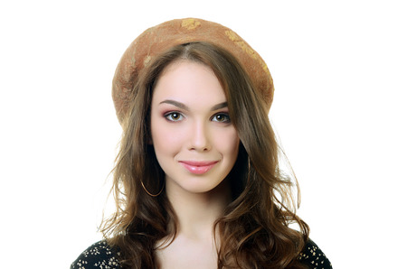 The beautiful woman in beret on head photo