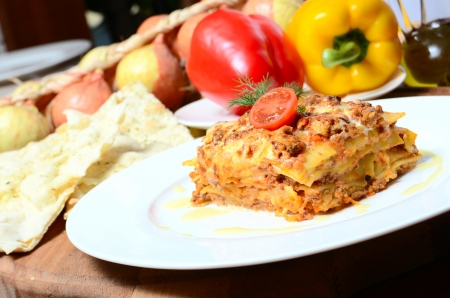 The Italian lasagna on a white  plate photo