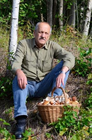 Basket with boletus edulis on a grass photo