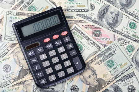 calculator on dollar background , business concept Stock Photo - 22741931