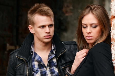 The man and woman against a wall Stock Photo - 23139918