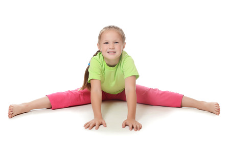 Little girl in sportswear isolated on white photo