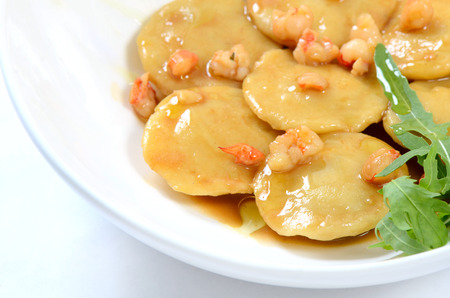 raviolo: House ravioli the filled fillets dorado with sauce from shrimps Stock Photo