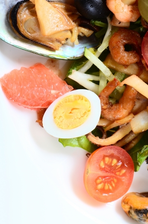 Salad with seafood with a squid, a tuna fillet, meat of mussels photo