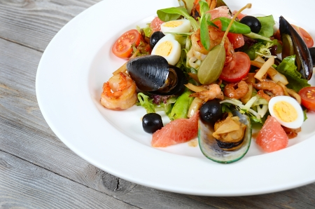 seafood salad: Salad with seafood with a squid, a tuna fillet, meat of mussels Stock Photo