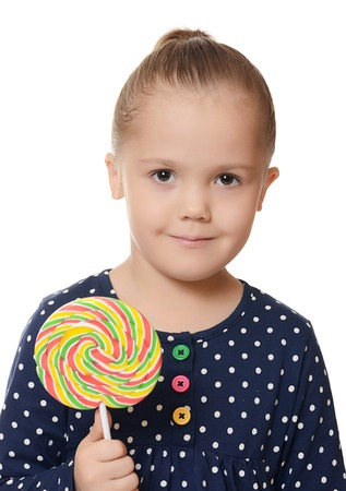 Little girl with lollipop isolated on white photo