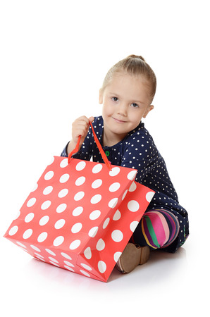 The little girl with a packages isolated photo