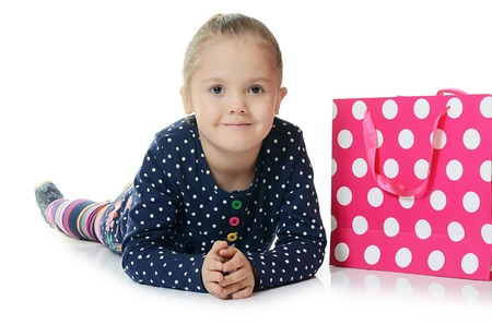 The little girl with two packages isolated photo