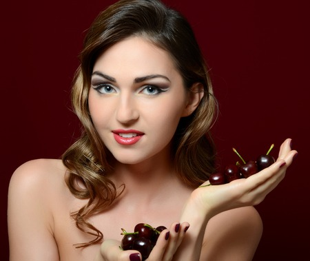 The beautiful woman with a sweet cherry photo