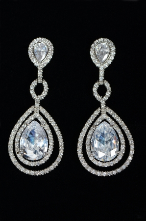 zircon: Silver earrings with jewels on the black