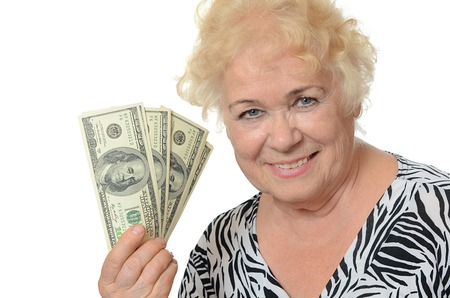 Elderly woman with dollars isolated on white photo