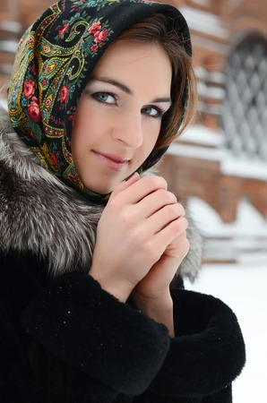 The beautiful woman brunette in the winter photo