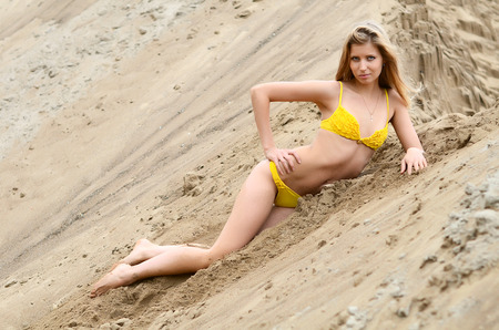 The beautiful woman in bikini on sand photo