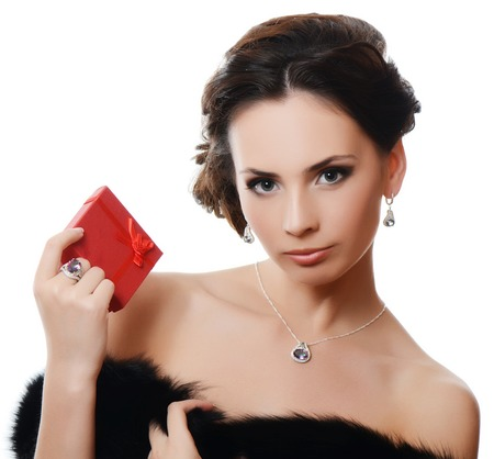 The beautiful sensual  woman with expensive jewelry photo