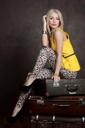 The beautiful woman with old retro suitcases photo