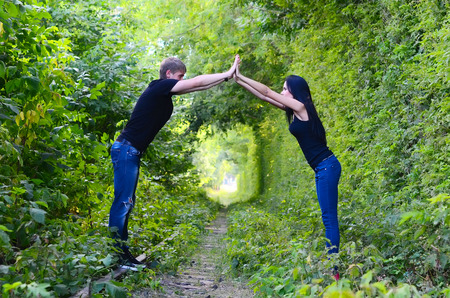 enamoured: Enamoured young pair on the old railway Stock Photo