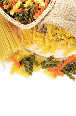 Uncooked pasta spaghetti macaroni isolated on white photo
