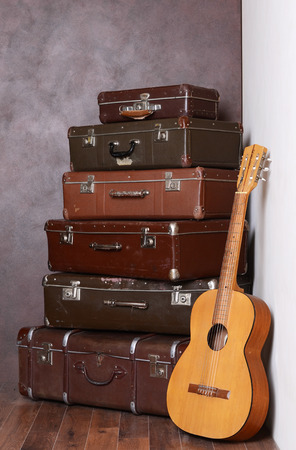 The old retro suitcases at a wall photo