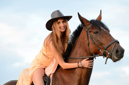 horse blonde: The woman on horse against the sky
