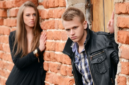 The man and woman against a wall photo