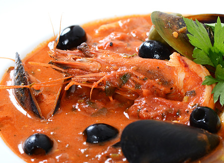seafood soup: Tomato soup with fish and seafood
