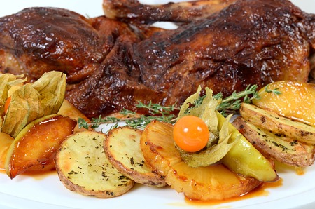roasted turkey: The baked half of duck with a potato, apples and pineapple