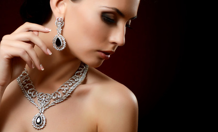 expensive: The beautiful woman in expensive pendant close-up Stock Photo