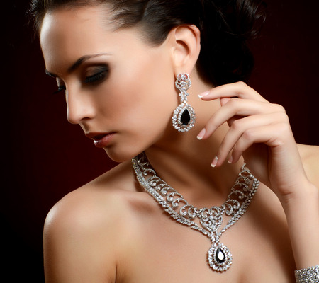 beautiful model: The beautiful woman in expensive pendant close-up Stock Photo