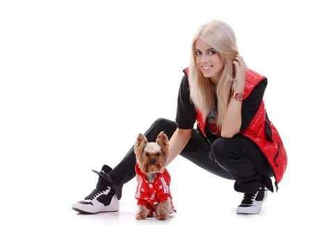 The young beautiful fashionable  blonde girl with a cute little dog Yorkshire terrier photo