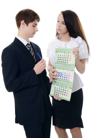 The businessman and businesswoman hold a calendar photo