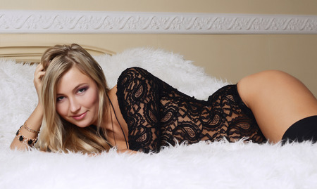 The beautiful girl the blonde on bed photo