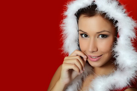The Christmas girl on a red background photo