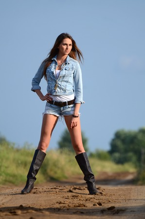 sexy boots: The woman in jeans shorts on road