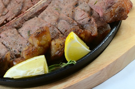 the stake from mutton with a lemon photo