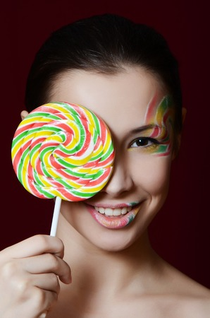 The beautiful girl with a sugar candy photo