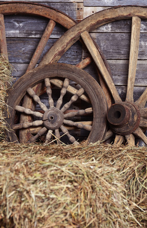 Old wheels from a cart in shed photo