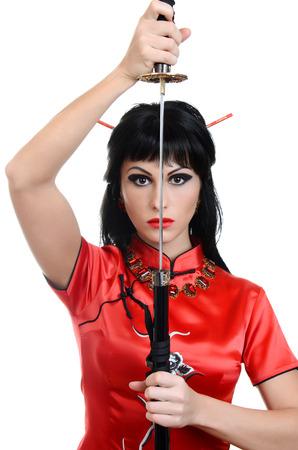 Beautiful geisha in kimono with samurai sword photo